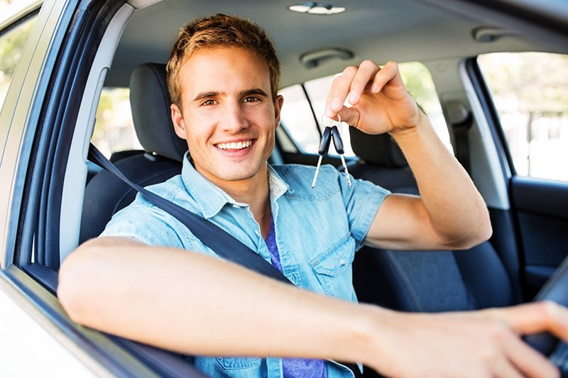 driver picks up keys to their new car