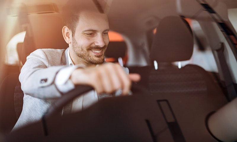 Men favour looks and performance over functionality and price, according to research on car buying habits.