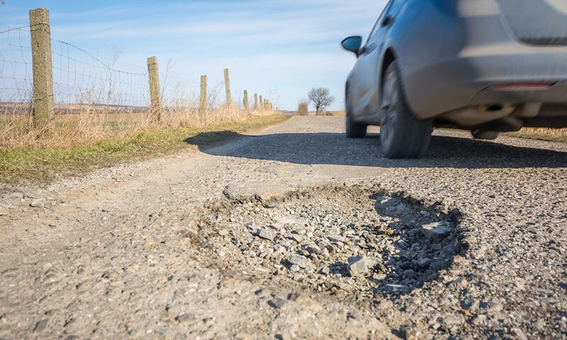 Drivers are swerving onto the wrong side of the road to avoid the danger of hitting a pothole
