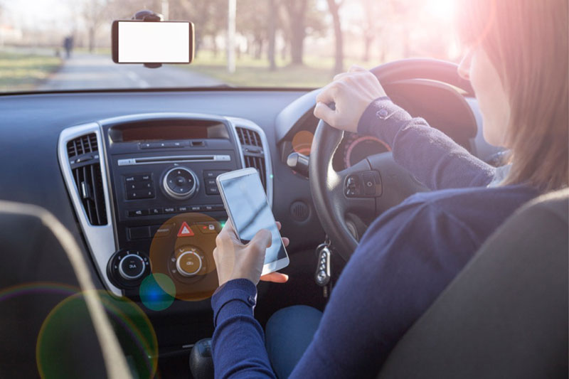 A third of motorists are still using their phones behind the wheel.