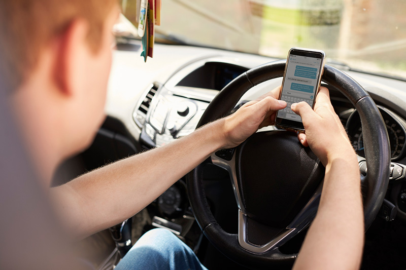 Blanket ban on mobile phone use while driving closes legal loophole
