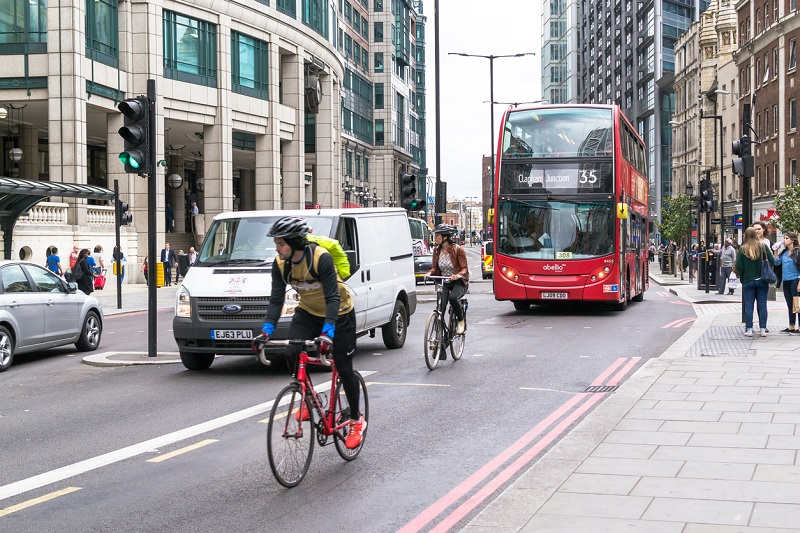Cyclists on busy London street.