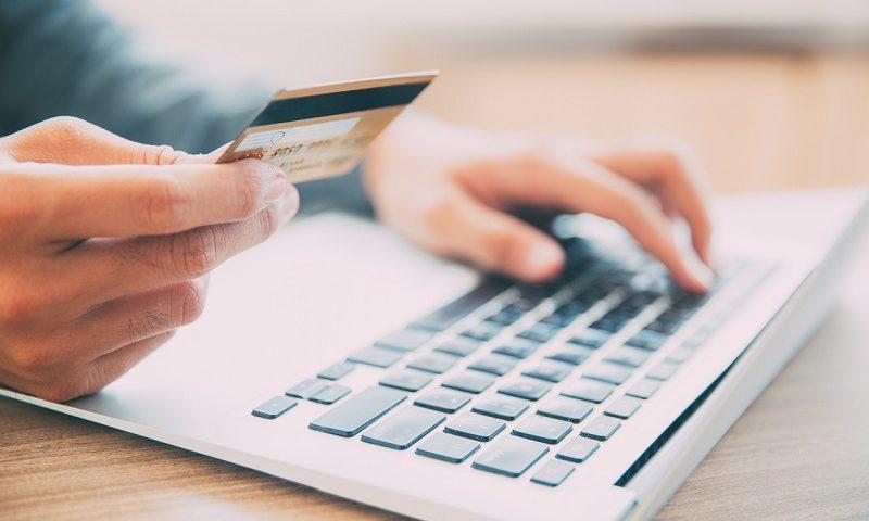 Man making purchase on laptop