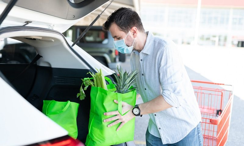 Man loading car with groceries