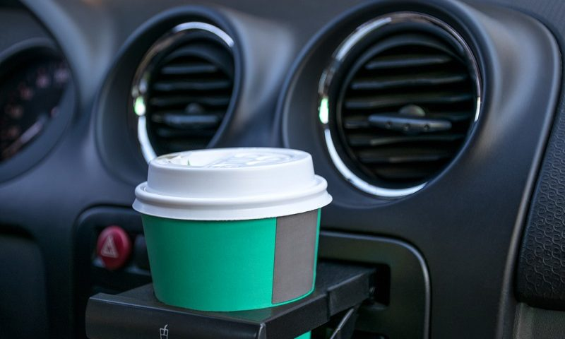 Paper cup in car cup holder