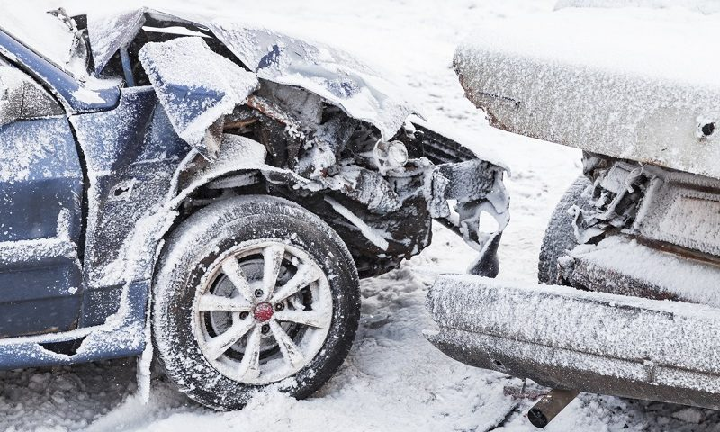 Collision of two cars in snow.