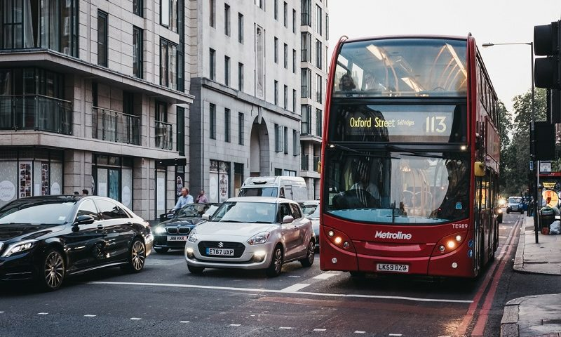 Cars and a double decker bus
