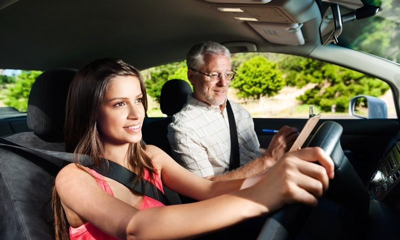 A learner driving with an instructor