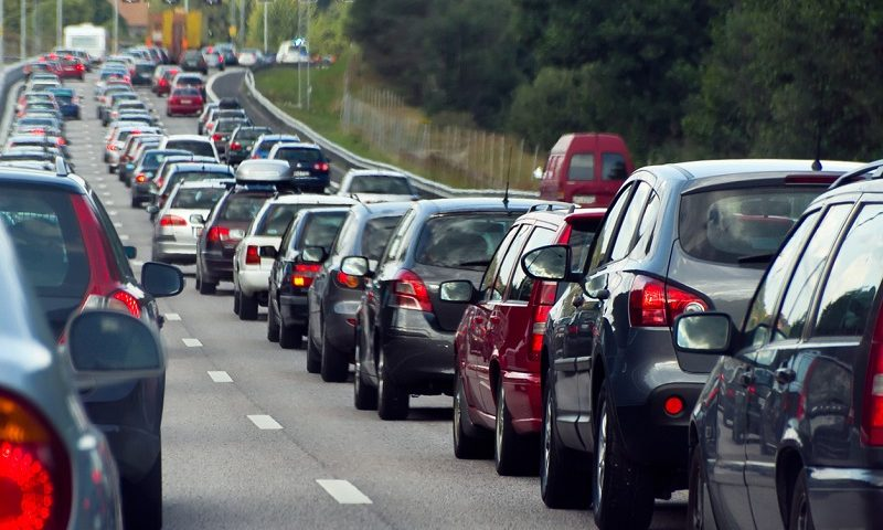 A row of cars sit in a traffic jam