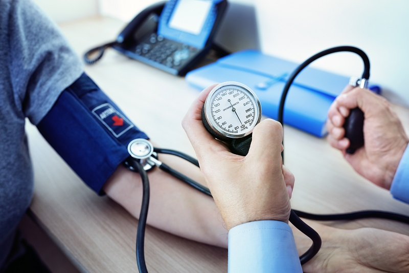 A doctor checks a patient's blood pressure