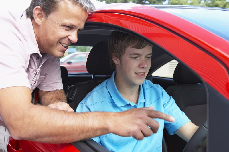 A teenage boy learning how to drive