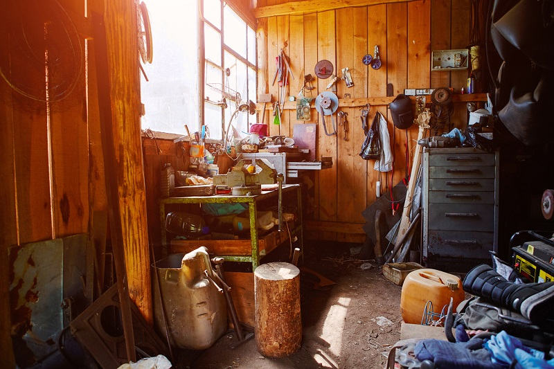 A garage being used as a workshop and storage room