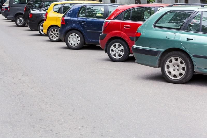 A line of cars parked outside