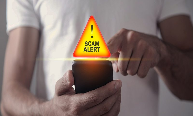 Someone receiving a scam message on their smart phone