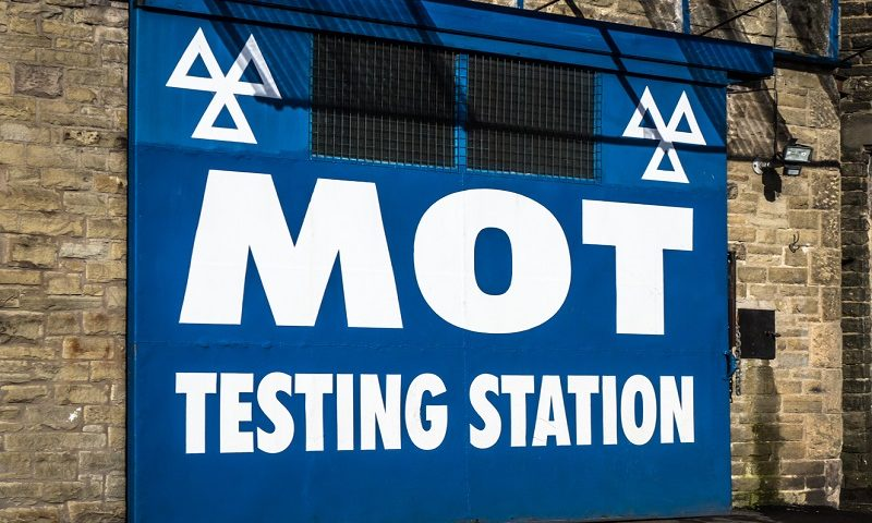 Large sign of an MOT testing station in the UK