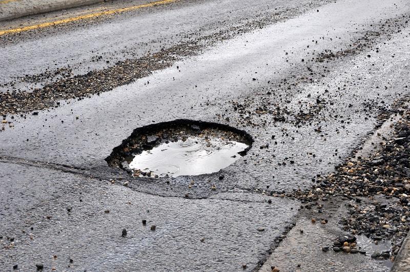 Pothole damaged road