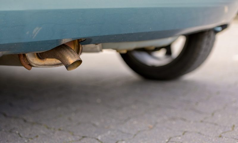 Exhaust pipe on an older car with a diesel engine