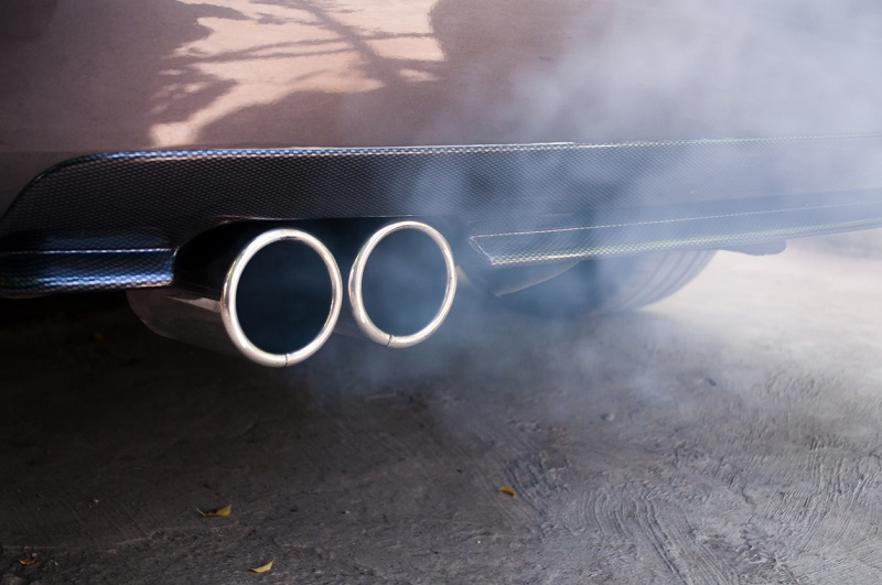Smoke emissions from exhaust pipe in car